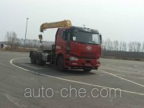 Tractor unit mounted loader crane